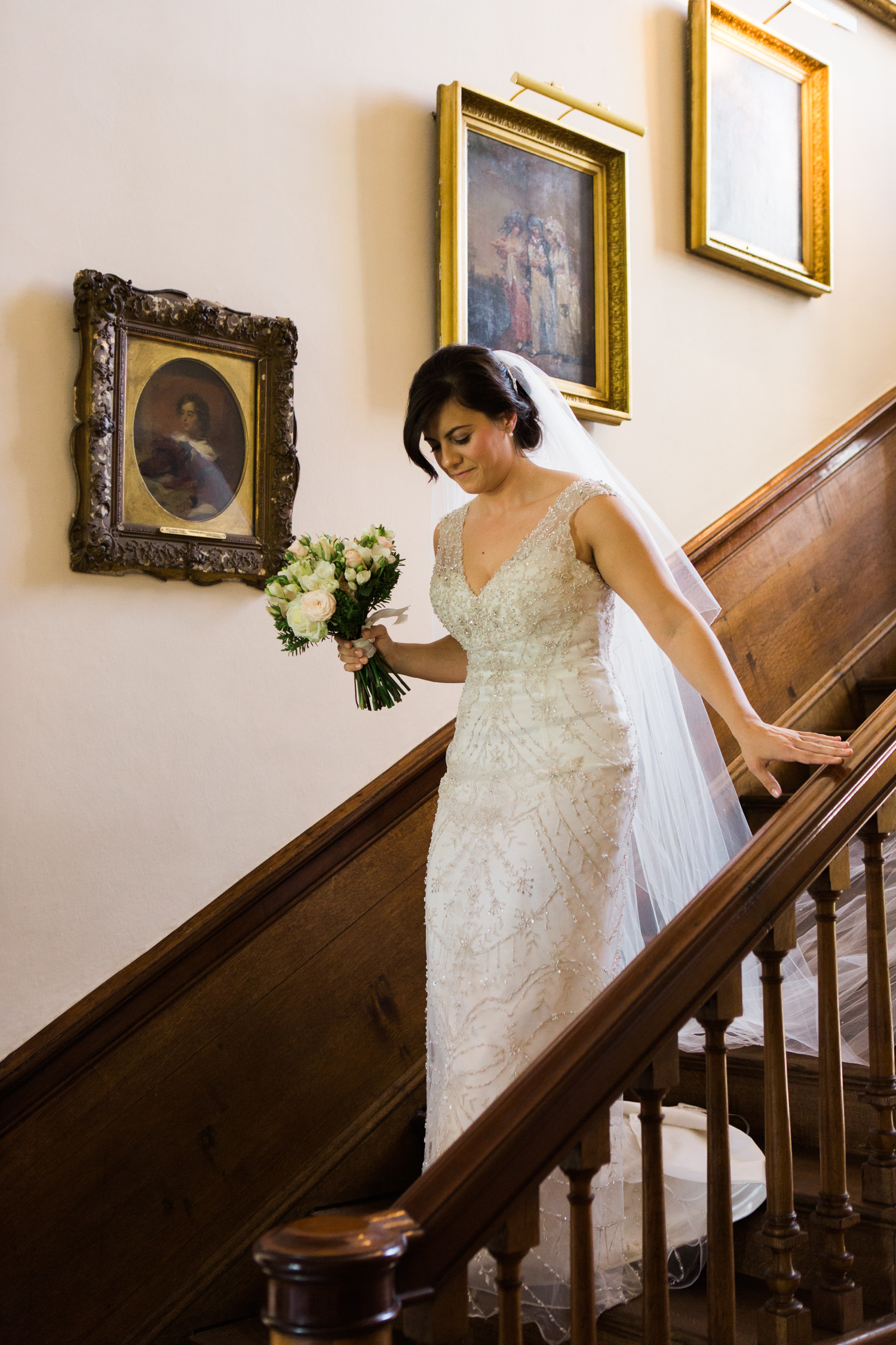 Bride on staircase at Iscoyd Park wedding photo