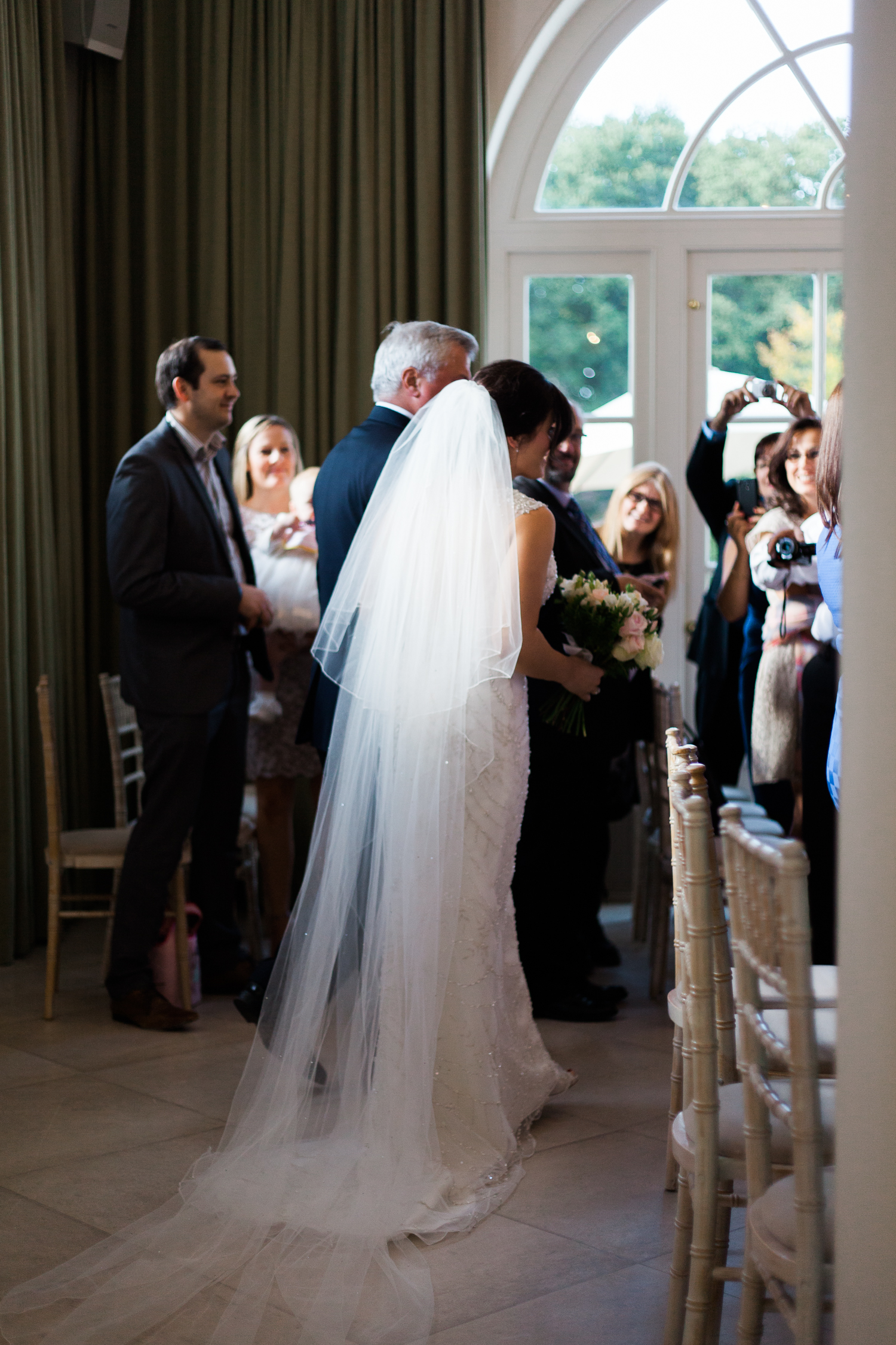 Arrival of the bride at Iscoyd Park wedding ceremony photo