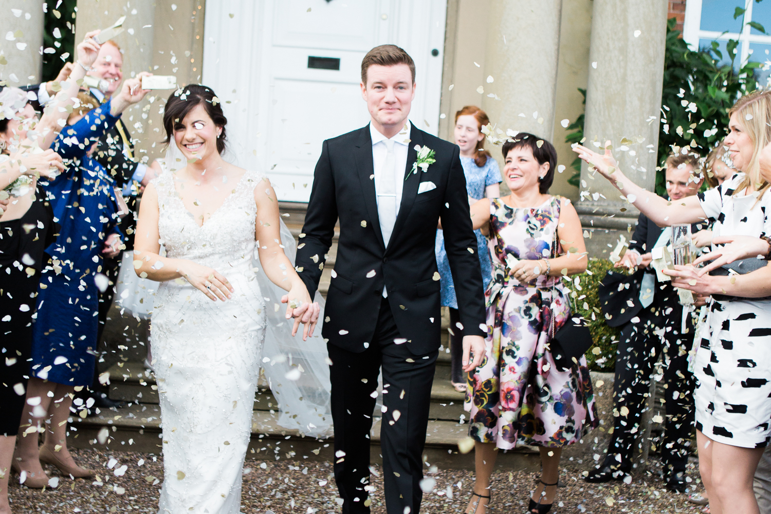 Confetti shot at wedding at Iscoyd Park at front of house photo