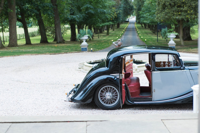 Vintage Jaguar Wedding Car at Carlowrie Castle in Edinburgh photo