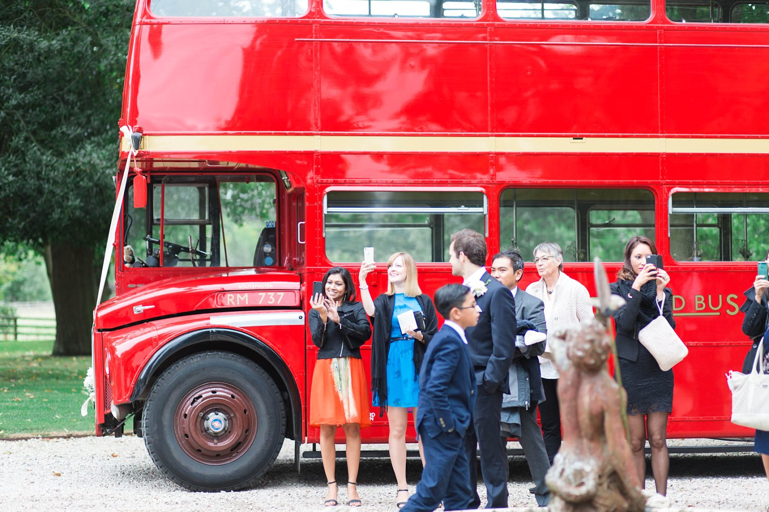 Red London Bus at a luxury wedding at Carlowrie Castle, Edinburgh photo