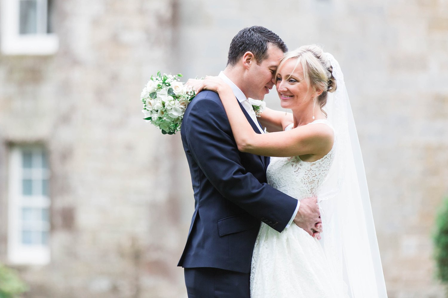 Bride and groom portraits at a luxury castle wedding in Scotland. Fine art wedding photography in the UK.